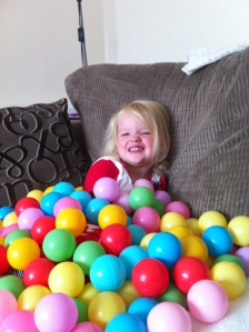 Emily covered in balls